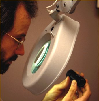 using a large stand magnifier with its own light